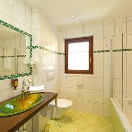 Mountainbikehotel: Badezimmer Junior Suite - Hotel Almrausch